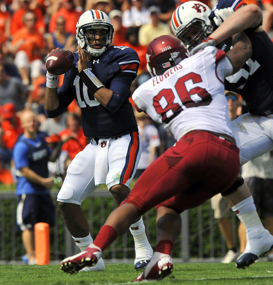 Auburn quarterback Kieihl Frazier looks for a reciever against Arkansas during the first half of their NCAA college football game on Saturday, Oct. 6, 2012 in Auburn, Ala. (AP Photo/Todd J. Van Emst)