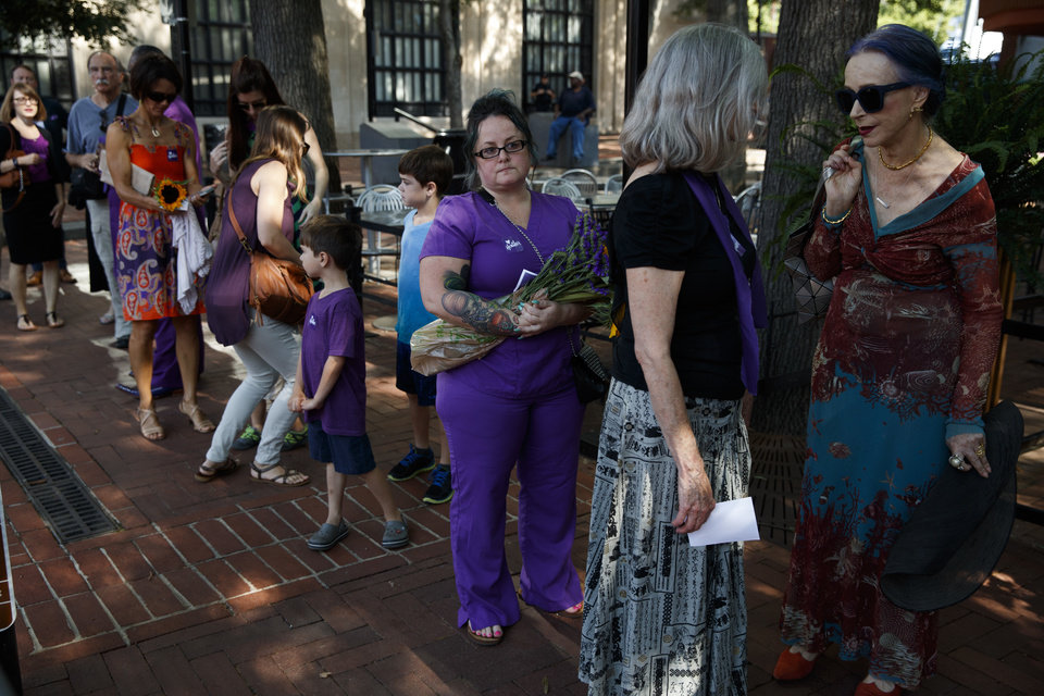 Photo - Cynthia Sullivan of Charlottesville, Va., third from right, stands in line for a memorial service for Heather Heyer, who was killed during a white nationalist rally, Wednesday, Aug. 16, 2017, in Charlottesville, Va. (AP Photo/Evan Vucci)