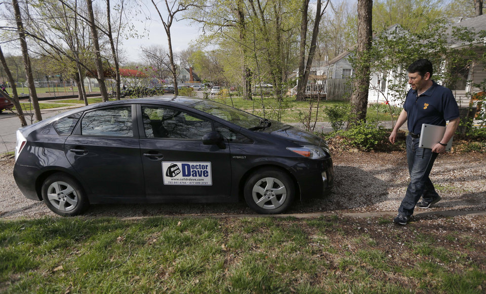 Photo - In this Monday, April 21, 2014 photo, Dave Greenbaum, who runs a computer repair business, walks to his vehicle outside his house in Lawrence, Kan. Despite increasing acceptance of homosexuality in the U.S., gay small business owners like Greenbaum say they still encounter discrimination from possible customers and investors. (AP Photo/Orlin Wagner)