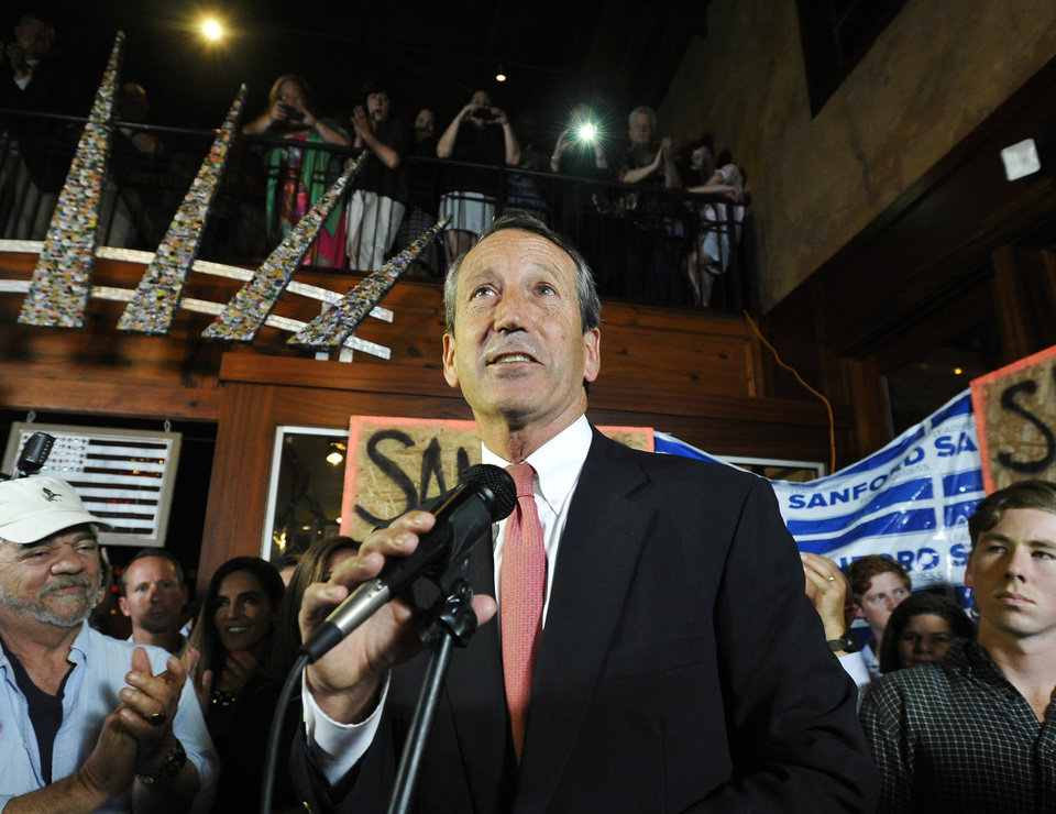 Photo - Former South Carolina Gov. Mark Sanford gives his victory speech after wining back his old congressional seat in the state's 1st District on Tuesday, May 7, 2013, in Mt. Pleasant, S.C. (AP Photo/Rainier Ehrhardt)