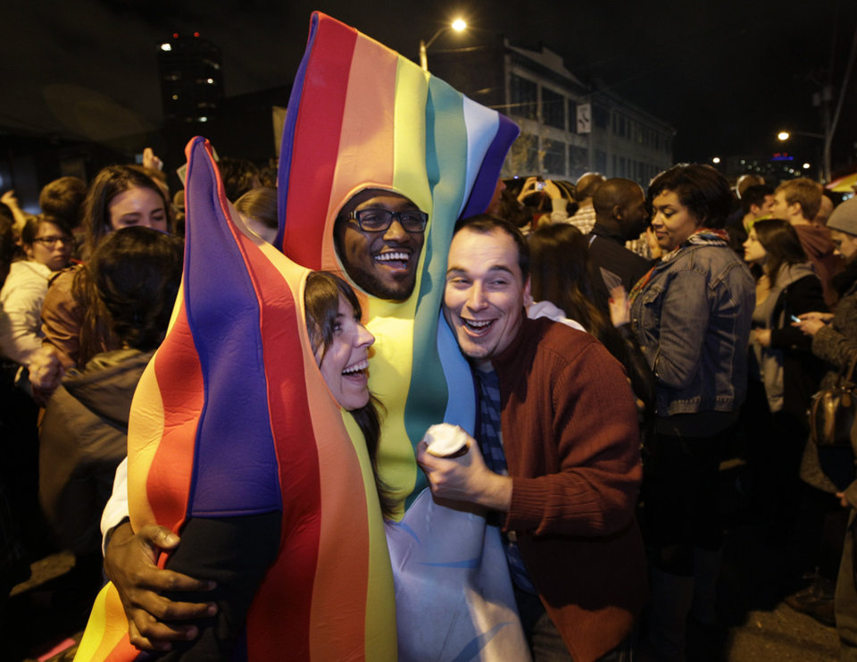 People celebrate early election returns favoring Washington state Referendum 74, which would legalize gay marriage, during a large impromptu street gathering in Seattle's Capitol Hill neighborhood, Tuesday, Nov. 6, 2012. The re-election of President Barack Obama and Referendum 74 drew the most supporters to the streets. (AP Photo/Ted S. Warren)