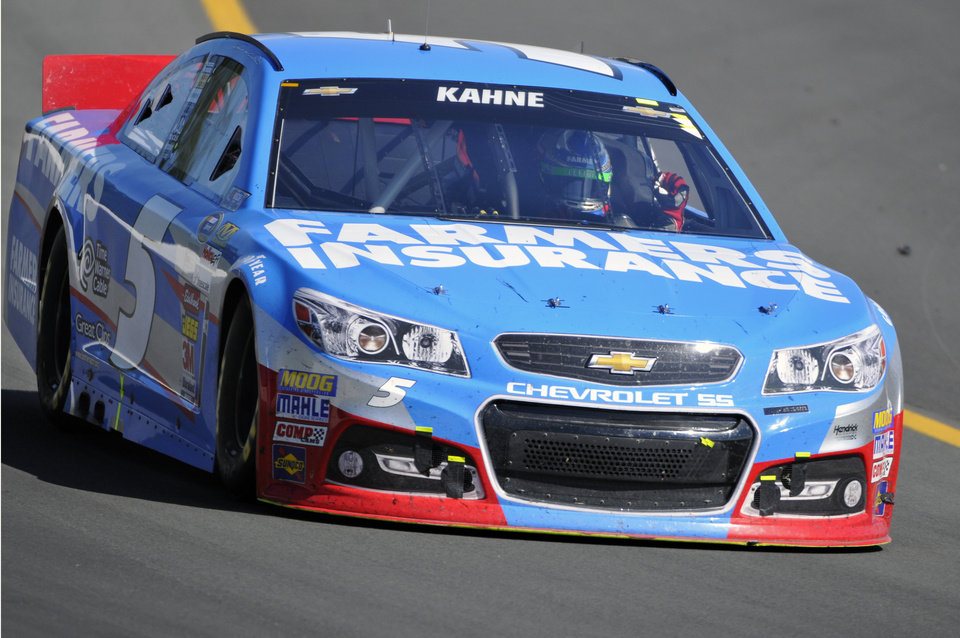 Photo - Kasey Kahne (5) pumps his fist as he drives around the track after winning a NASCAR Sprint Cup Series auto race, Sunday Aug. 4, 2013, at Pocono Raceway in Long Pond, Pa. Jeff Gordon was second. (AP Photo/Derik Hamilton)