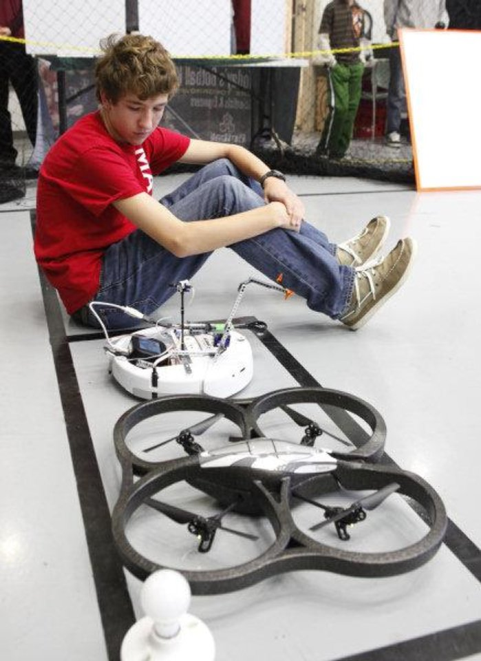 Vasiliy Pobedinski, from St. John's School in Houston, waits for his drone's computer to reboot on Saturday.