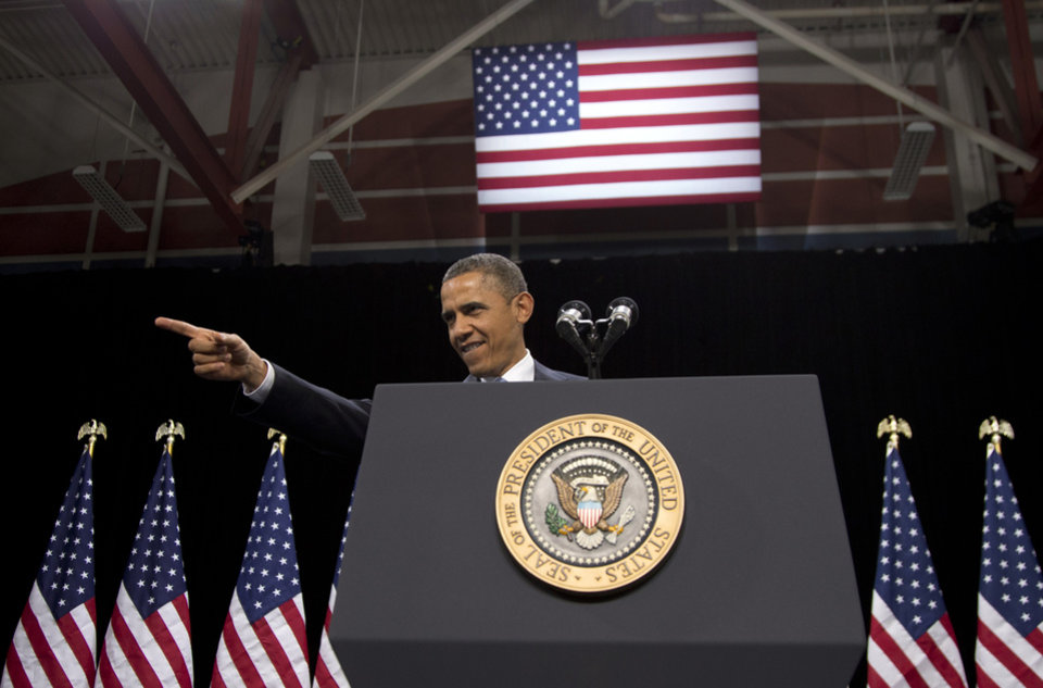 President Barack Obama points to someone in the crowd as he arrives to speak about immigration at Del Sol High School, Tuesday, Jan. 29, 2013, in Las Vegas. (AP Photo/Carolyn Kaster)