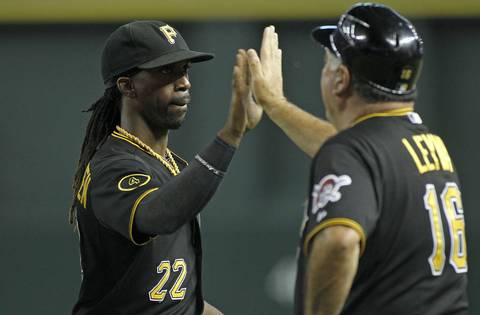 Photo - Pittsburgh Pirates' Andrew McCutchen (22) is congratulated by third base coach Nick Levya following a 9-4 victory against the Arizona Diamondbacks during a baseball game, Friday, Aug. 1, 2014, in Phoenix. (AP Photo/ Ralph Freso)