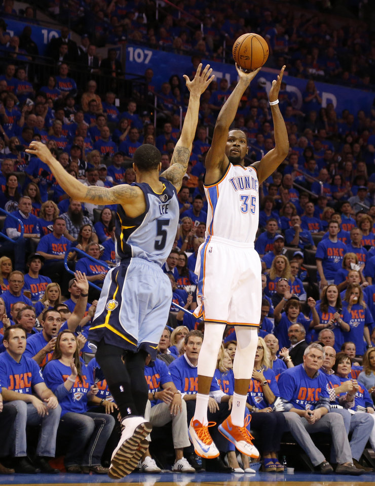 Photo - Oklahoma City's Kevin Durant (35) shoots over Memphis' Courtney Lee (5) during Game 7 in the first round of the NBA playoffs between the Oklahoma City Thunder and the Memphis Grizzlies at Chesapeake Energy Arena in Oklahoma City, Saturday, May 3, 2014. Photo by Nate Billings, The Oklahoman