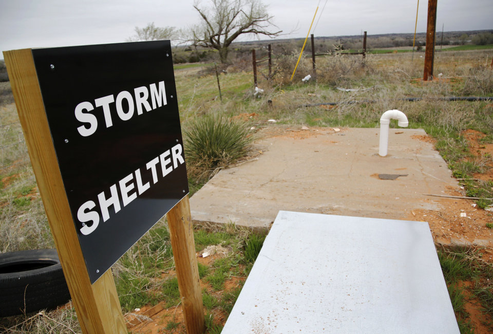 Photo - A new sign and storm shelter have been placed on the western edge of the Hide-A-Way Mobile Home Park in Woodward after last year's tornado.
