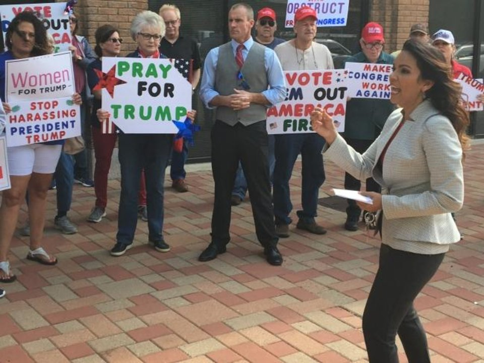 Photo -  Estela Hernandez, former vice chair of the Oklahoma Republican Party, speaks at a rally on Thursday in downton Oklahoma City against impeachment of President Donald Trump. [Chris Casteel/The Oklahoman]