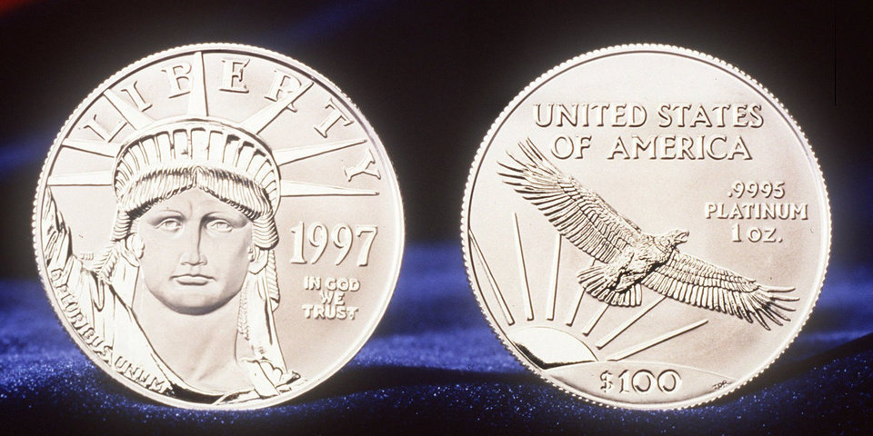 Photo -  This is a U.S. Mint handout of the one-ounce $100 platinum coin. The coin, also to be sold in half-ounce, quarter-ounce and tenth-ounce versions, bears a portrait of the Statue of Liberty on the front and a soaring eagle on the back. [AP Photo]