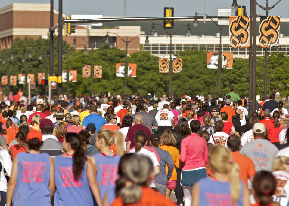 Runners fill Hall of Fame road during the Remember the Ten run held in Stillwater, Okla., on April 21, 2012. Photos by Mitchell Alcala for The Oklahoman  ORG XMIT: KOD