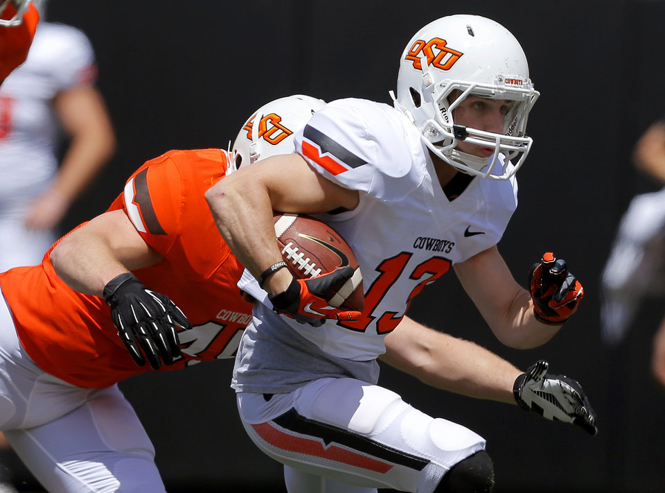 Oklahoma State\'s David Gidden runs past Caleb Lavey during OSU\'s spring football game at Boone Pickens Stadium in Stillwater, Okla., Sat., April 20, 2013. Photo by Bryan Terry, The Oklahoman