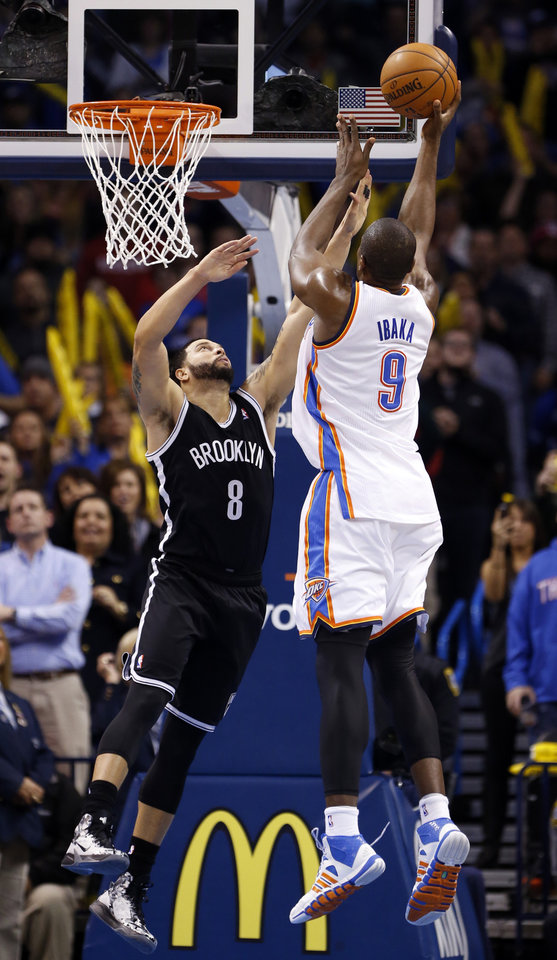 Serge Ibaka (9) ties the score with five second on the clock guarded by Brooklyn\'s Deron Williams in the second half of an NBA basketball game where the Oklahoma City Thunder were defeated 95-93 by the Brooklyn Nets at the Chesapeake Energy Arena in Oklahoma City, on Thursday, Jan. 2, 2014. Photo by Steve Sisney, The Oklahoman