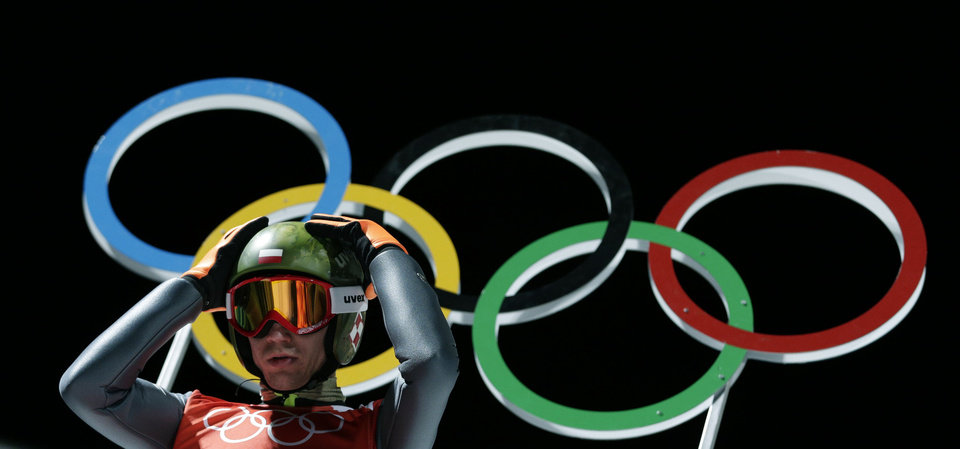 Photo - Poland's Kamil Stoch prepares for his jump during a men's ski jumping large hill training session at the 2014 Winter Olympics, Wednesday, Feb. 12, 2014, in Krasnaya Polyana, Russia. (AP Photo/Matthias Schrader)