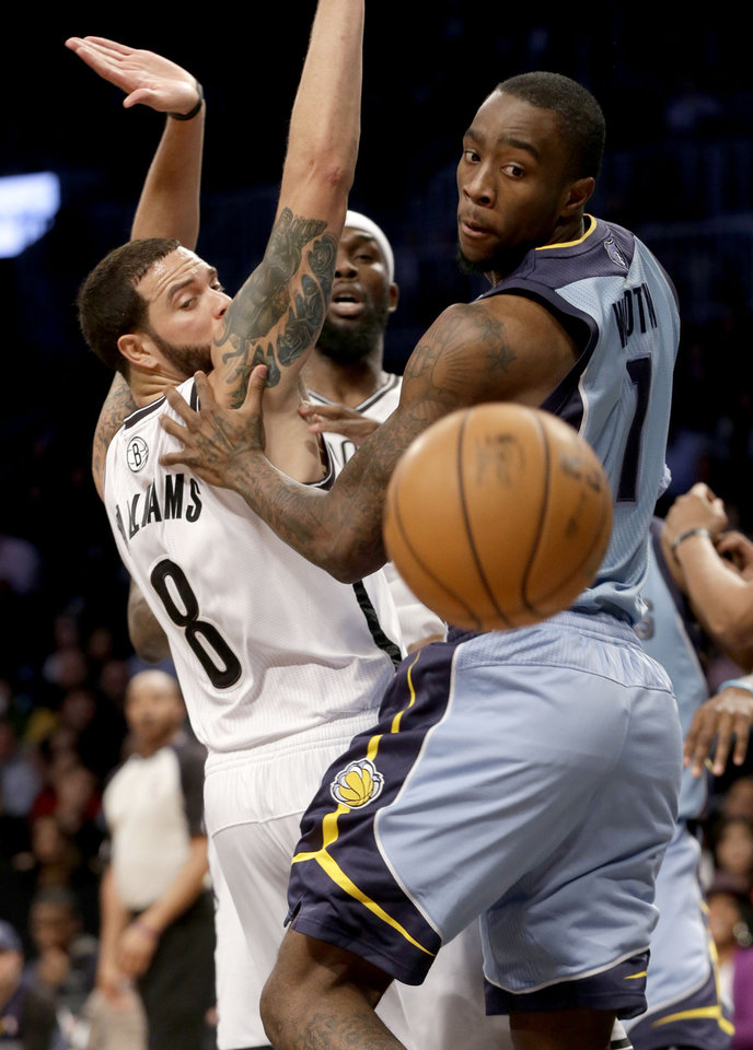 Memphis Grizzlies' Tony Wroten, right, and Brooklyn Nets' Deron Williams fight for a rebound during the first half of the NBA basketball game at the Barclays Center Sunday, Feb. 24, 2013 in New York.  (AP Photo/Seth Wenig)