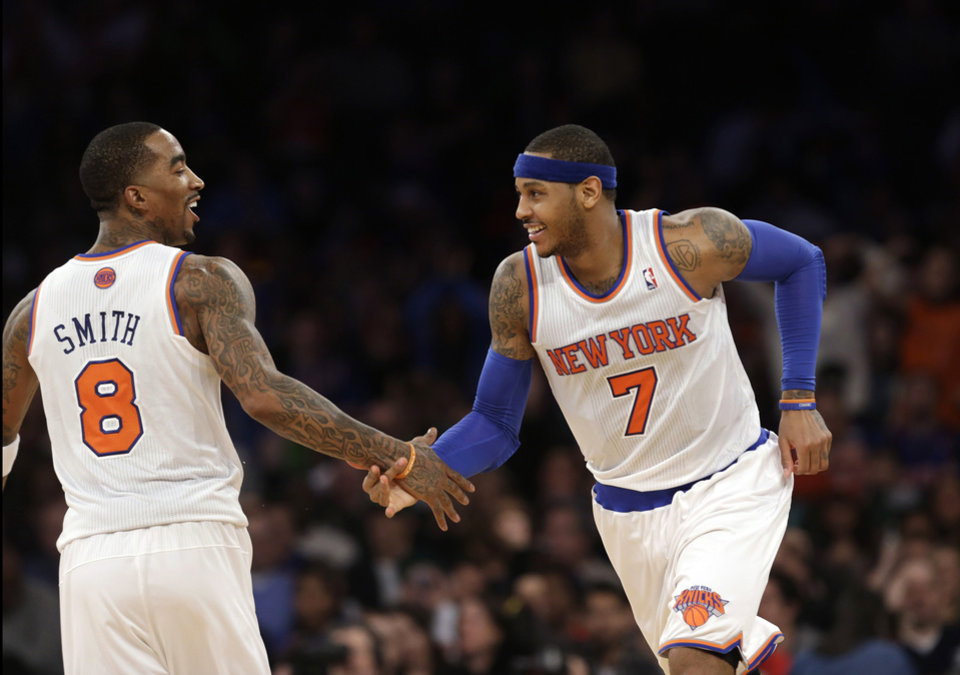 New York Knicks guard J.R. Smith (8), who scored 18 points, congratulates forward Carmelo Anthony (7) after Anthony hit a three-point shot in the second half of an NBA basketball game at Madison Square Garden in New York, Sunday, Jan. 27, 2013.  Anthony scored 42 points, including nine three-point shots as the Knicks defeated the Hawks 106-104. (AP Photo/Kathy Willens)