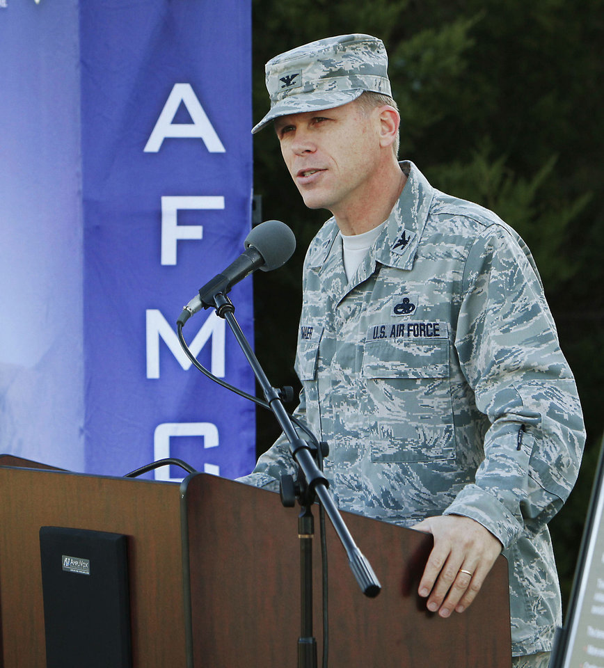 Photo - 72nd Air Base Wing commander Col. Steve Bleymaier speaks Tuesday.