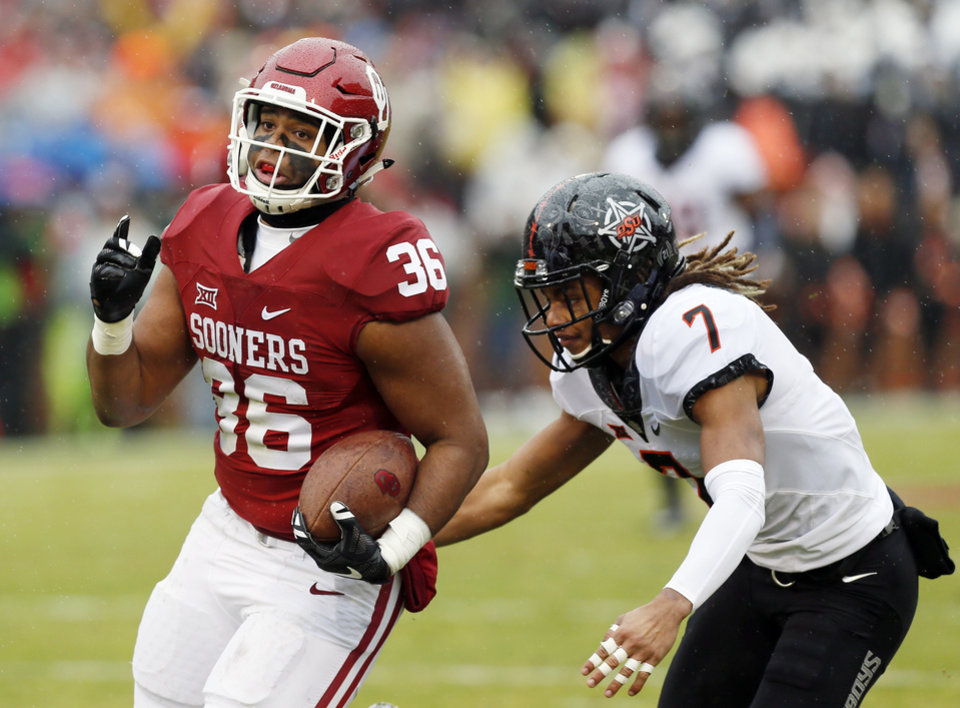 Photo - Oklahoma's Dimitri Flowers (36) runs after a catch in front of Oklahoma State's Ramon Richards (7) in the second quarter during the Bedlam college football game between the Oklahoma Sooners (OU) and the Oklahoma State Cowboys (OSU) at Gaylord Family - Oklahoma Memorial Stadium in Norman, Okla., Saturday, Dec. 3, 2016. Photo by Nate Billings, The Oklahoman