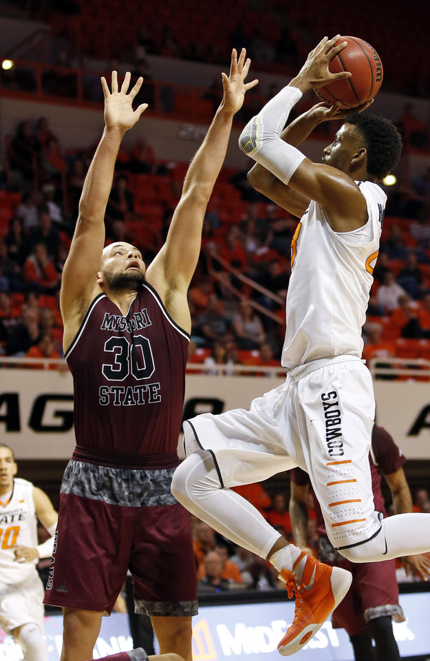 Photo - OSU's Leyton Hammonds (23) shoots against Missouri State's Camyn Boone (30) during a men's college basketball game between Oklahoma State and Missouri State at Gallagher-Iba Arena in Stillwater, Okla., Saturday, Dec. 5, 2015. Missouri State won 64-63. Photo by Nate Billings, The Oklahoman