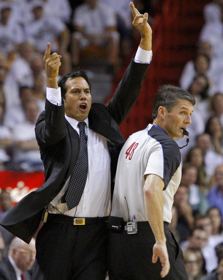 Photo - Miami coach Erik Spoelstra shouts to his team beside official Scott Foster during Game 4 of the NBA Finals between the Oklahoma City Thunder and the Miami Heat at American Airlines Arena, Tuesday, June 19, 2012. Photo by Bryan Terry, The Oklahoman