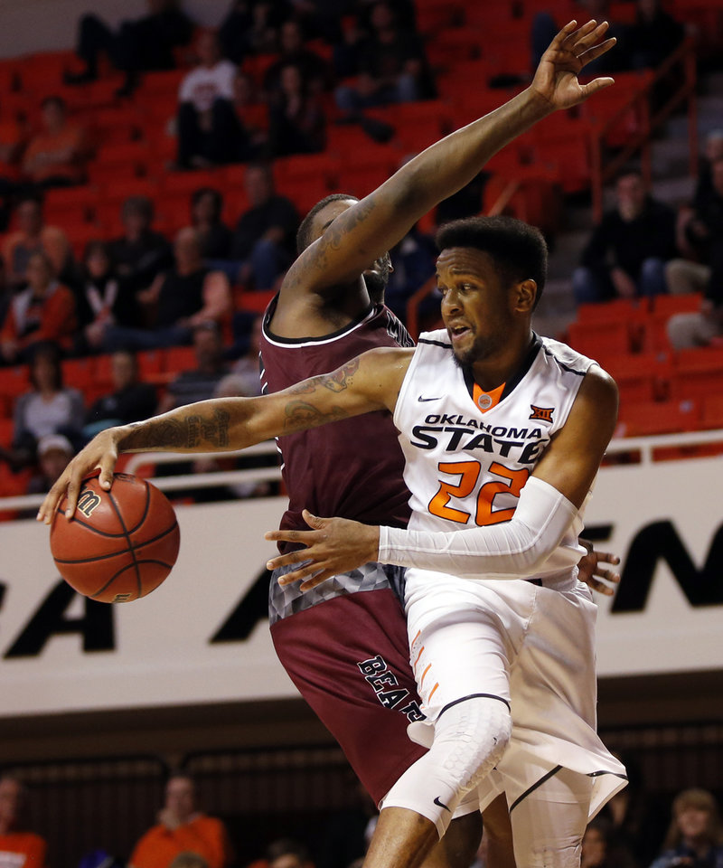 Photo - OSU's Jeff Newberry (22) passes around Missouri State's Jordan Martin (25) during a men's college basketball game between Oklahoma State and Missouri State at Gallagher-Iba Arena in Stillwater, Okla., Saturday, Dec. 5, 2015. Missouri State won 64-63. Photo by Nate Billings, The Oklahoman