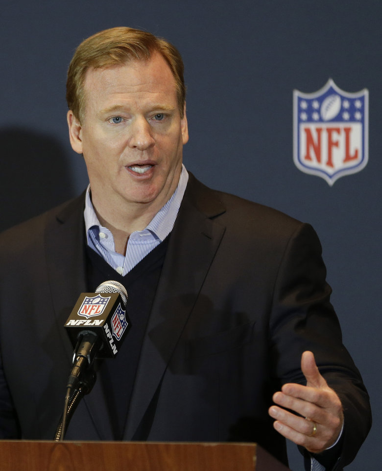 Photo - FILE - In this March 26, 2014, file photo, NFL Commissioner Roger Goodell answers questions during a news conference at the NFL football annual meeting in Orlando, Fla. Goodell told a gathering of Associated Press Sports Editors on Thursday, April 24, 2014, that a vote is uncertain on the proposal to add two teams to the postseason. (AP Photo/John Raoux, File)