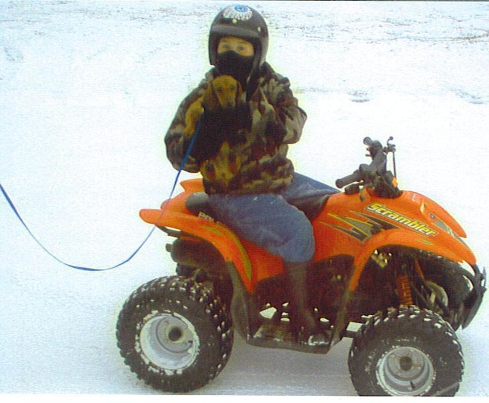 Bryan and Buddy having there fun on the 4-wheeler!<br/><b>Community Photo By:</b> Millie Garner<br/><b>Submitted By:</b> jimmy, Norman