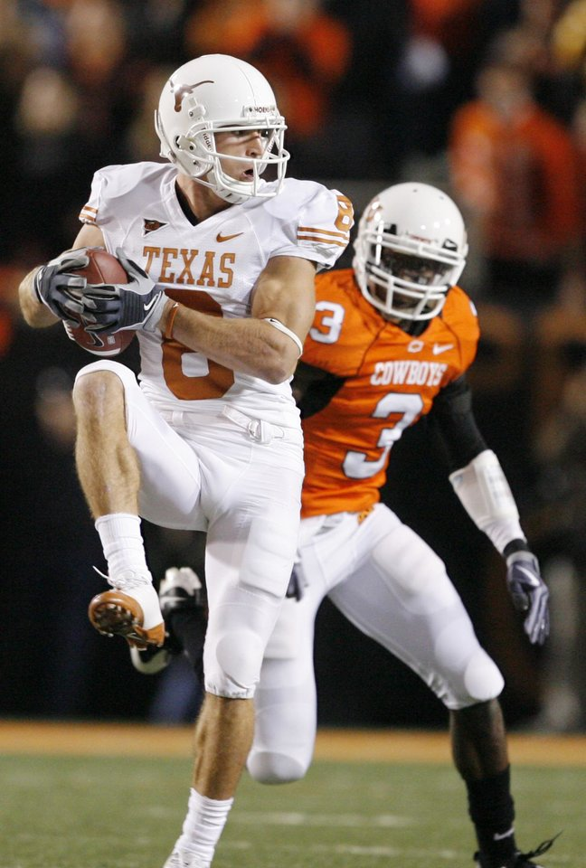 Photo - Jordan Shipley (8) of Texas catches a pass in front of Victor Johnson (3) of OSU during the college football game between the Oklahoma State University Cowboys (OSU) and the University of Texas Longhorns (UT) at Boone Pickens Stadium in Stillwater, Okla., Saturday, Oct. 31, 2009. Photo by Nate Billings, The Oklahoman