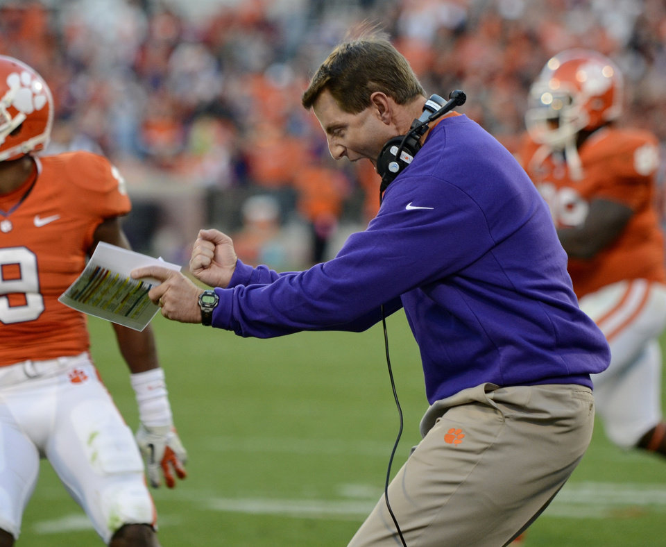 Clemson coach Dabo Swinney, right, reacts to a fumble recovery by his team during the first half of an NCAA college football game against North Carolina State, Saturday, Nov. 17, 2012, in Clemson, S.C. (AP Photo/Richard Shiro)