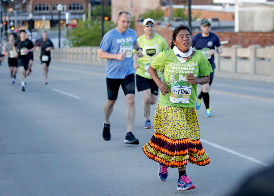 Photo - Lorena Ramierz runs up Walnut Street during Oklahoma City Memorial Marathon in Oklahoma City, Sunday, April 28, 2019. [Sarah Phipps/The Oklahoman]