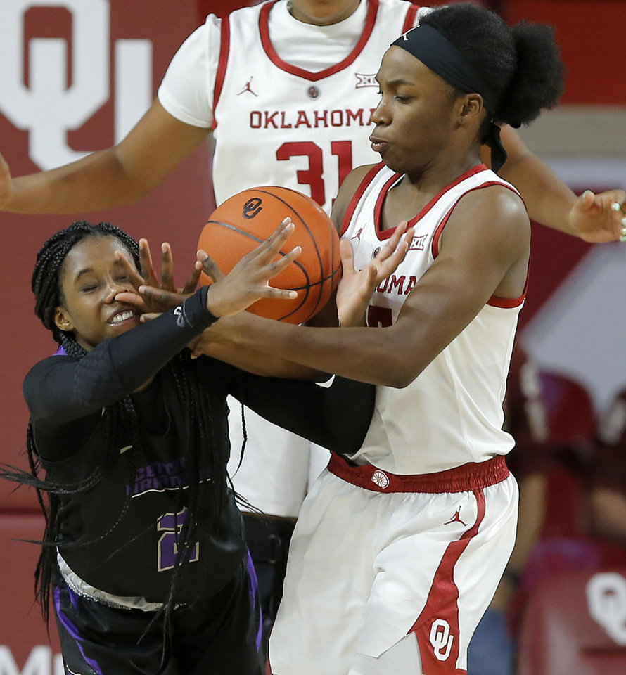 Photo - Oklahoma's Shaina Pellington (14) fights for the ball with Central Arkansas' Kamry Orr (2) during an NCAA women's basketball game between the University of Oklahoma (OU) and Central Arkansas at Loyd Noble Center in Norman, Okla., Wednesday, Dec. 5, 2018. Photo by Bryan Terry, The Oklahoman