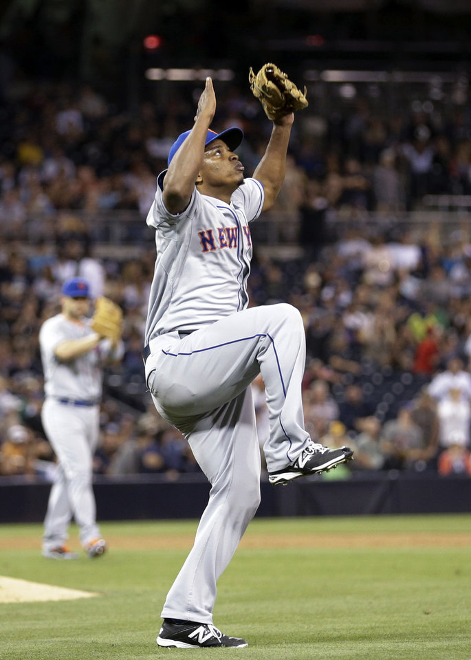 Photo - New York Mets closing pitcher Jenrry Mejia celebrates after the last out against the San Diego Padres in a baseball game Friday, July 18, 2014, in San Diego. The Mets won 5-4. (AP Photo/Gregory Bull)