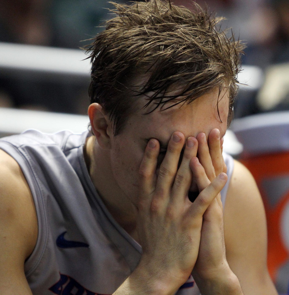 Photo - Boise State's Anthony Drmic sits on the bench after fouling out against Iowa State during an NCAA college basketball game at the Diamond Head Classic, Wednesday, Dec 25, 2013, in Honolulu. (AP Photo/The Idaho Statesman, Darin Oswald) LOCAL TV OUT (KTVB 7)