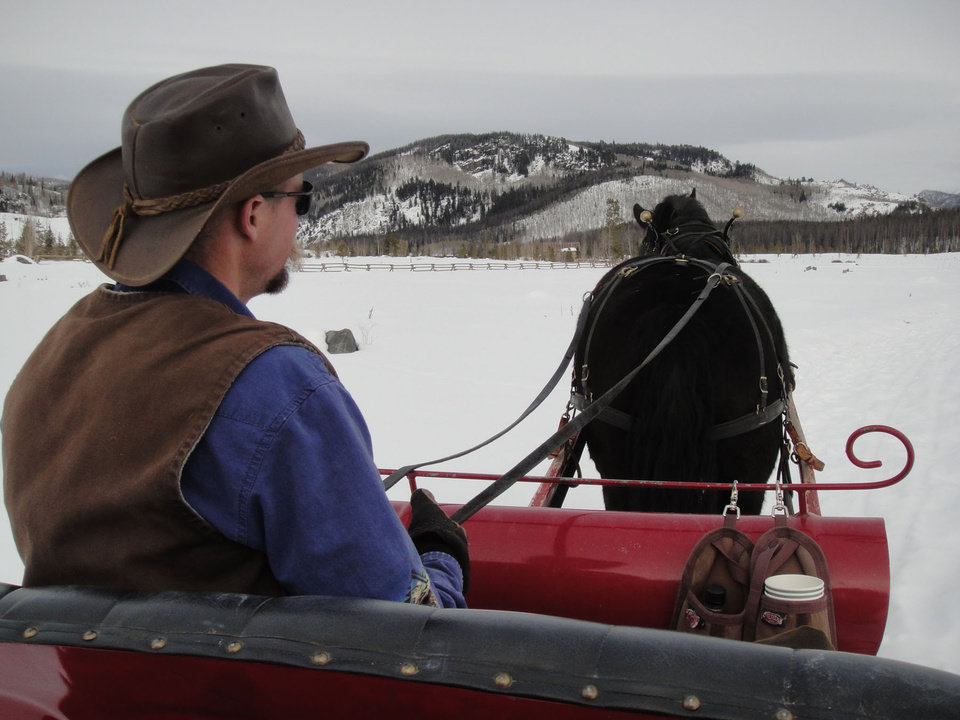 Photo -  Hot cocoa and thick blankets make a sleigh ride around Vista Verde ranch in Steamboat Springs, Colo., a magical event on a snowy afternoon. Photo courtesy of Lesley Sauls.