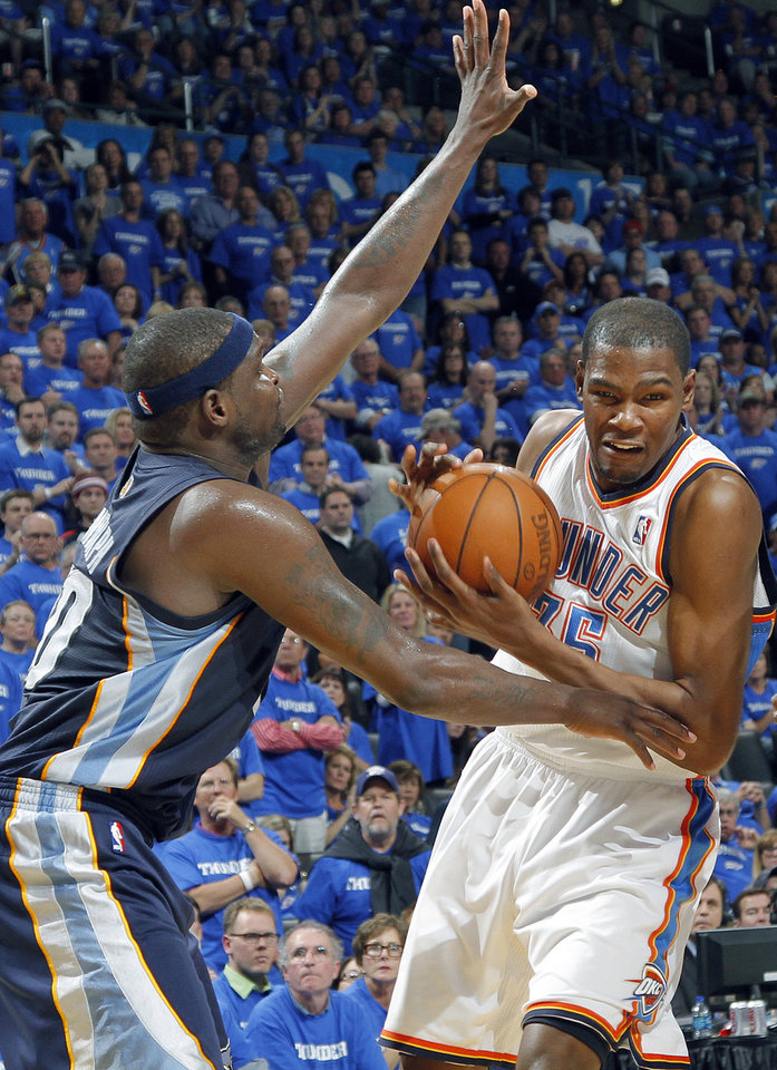 Photo - Oklahoma City's Kevin Durant (35) is defended on by Zach Randolph (50) of Memphis during game two of the Western Conference semifinals between the Memphis Grizzlies and the Oklahoma City Thunder in the NBA basketball playoffs at Oklahoma City Arena in Oklahoma City, Tuesday, May 3, 2011. Photo by Chris Landsberger, The Oklahoman