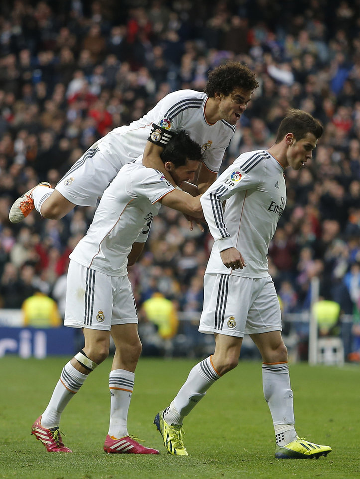 Photo - Real's Gareth Bale, right, celebrates his goal with team mates during a Spanish La Liga soccer match between Real Madrid and Elche at the Santiago Bernabeu stadium in Madrid, Spain, Saturday, Feb. 22, 2014. (AP Photo/Andres Kudacki)