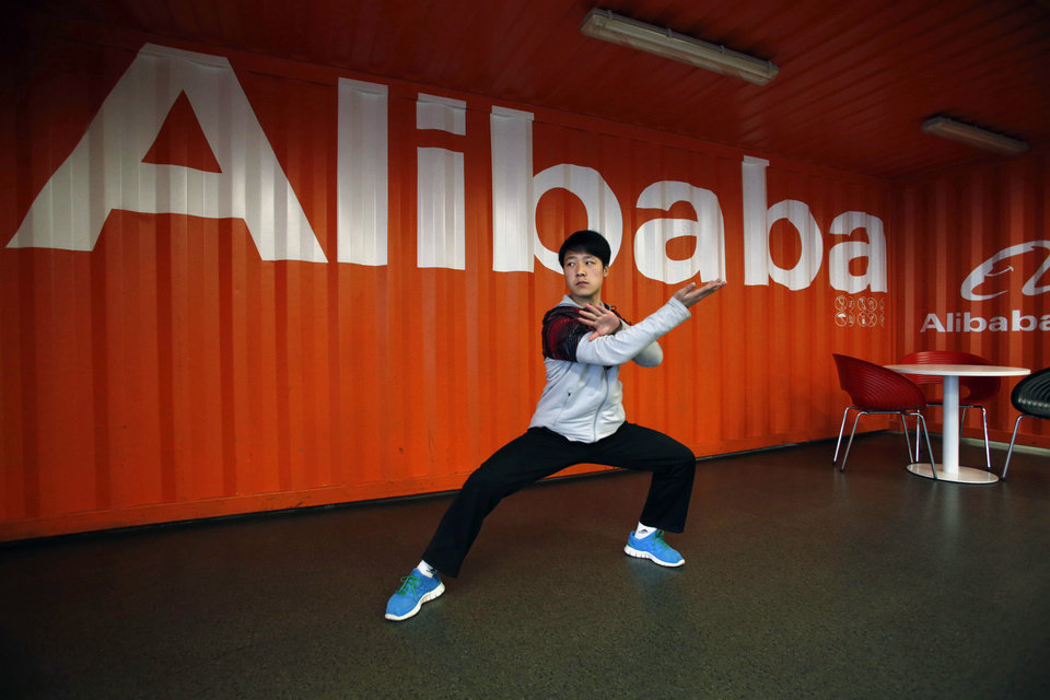 Photo - FILE - In this file photo taken Tuesday March 26, 2013, a worker performs shadow boxing during an open day at the Alibaba Group office in Hangzhou in east China's Zhejiang province. Alibaba Group is aiming to raise $1 billion in a long-awaited IPO likely to have ripple effects across the Internet. The Tuesday, May 6, 2014 filing sets the stage for the technology industry's biggest initial public offering since short messaging service Twitter and its early investors collected $1.8 billion in its stock market debut last fall.  (AP Photo) CHINA OUT