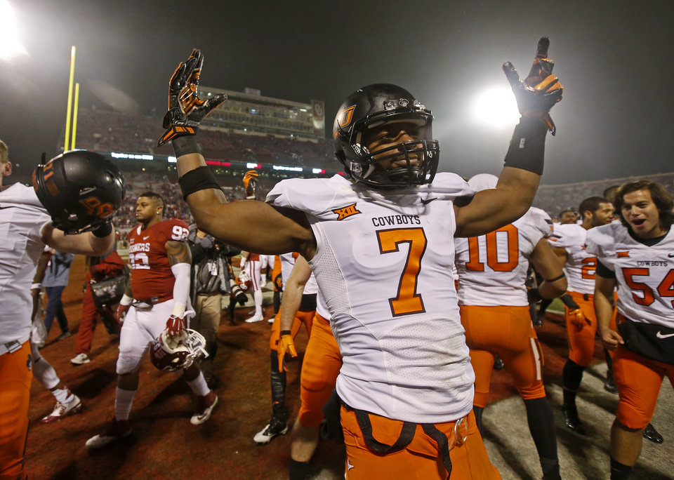 Photo - Oklahoma State's Brandon Sheperd (7) celebrates after a Bedlam college football game between the University of Oklahoma Sooners (OU) and the Oklahoma State Cowboys (OSU) at Gaylord Family-Oklahoma Memorial Stadium in Norman, Okla., Saturday, Dec. 6, 2014. Photo by Bryan Terry, The Oklahoman
