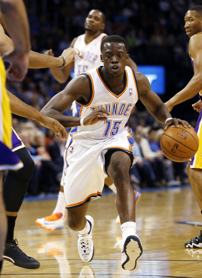 Photo - Oklahoma City Thunder's Reggie Jackson (15) brings the ball down in the first half of an NBA basketball game where the Oklahoma City Thunder play the Los Angeles Lakers at the Chesapeake Energy Arena in Oklahoma City, on March 13, 2014.  Photo by Steve Sisney The Oklahoman