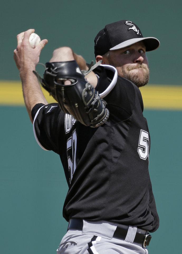 Photo - Chicago White Sox starting pitcher John Danks delivers against the Cincinnati Reds in the first inning of a spring training baseball game Tuesday, March 19, 2013, in Goodyear, Ariz. (AP Photo/Mark Duncan)