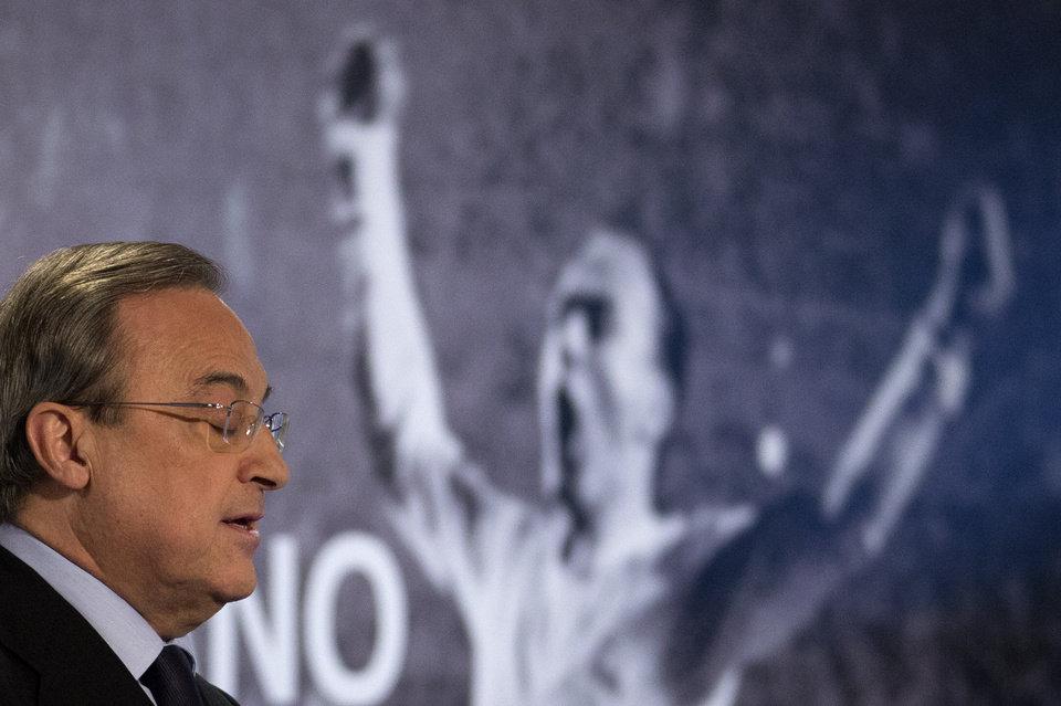 Photo - Real Madrid's President Florentino Perez makes a speech in front of a poster of Alfredo Di Stefano in the Santiago Bernabeu stadium before making a speech in Madrid, Spain, Monday, July 7, 2014 after football great Alfredo Di Stefano died. He was 88. The former Argentina forward was hospitalized on Saturday after a heart attack. He had been in a coma since at Gregorio Maranon hospital in the Spanish capital where he passed away. Di Stefano helped Madrid win five straight European Champions Cups from 1956-60 and eight Spanish league titles. He was voted European player of the year in 1957 and 1959. (AP Photo/Paul White)
