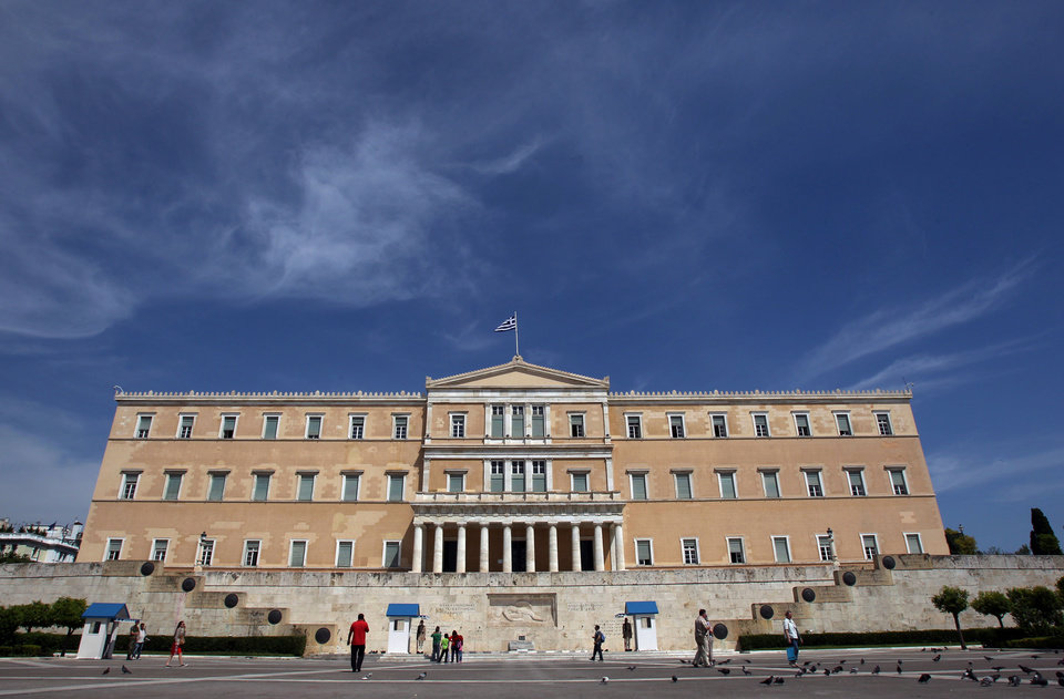 Photo -   The Greek Parliament is seen in Athens, Monday, May 7, 2012. Bailout-reliant Greece faces weeks of financial turmoil after voters angry at crippling income cuts punished mainstream politicians, let a far-right extremist group into Parliament and gave no party enough votes to govern alone. (AP Photo/Thanassis Stavrakis)