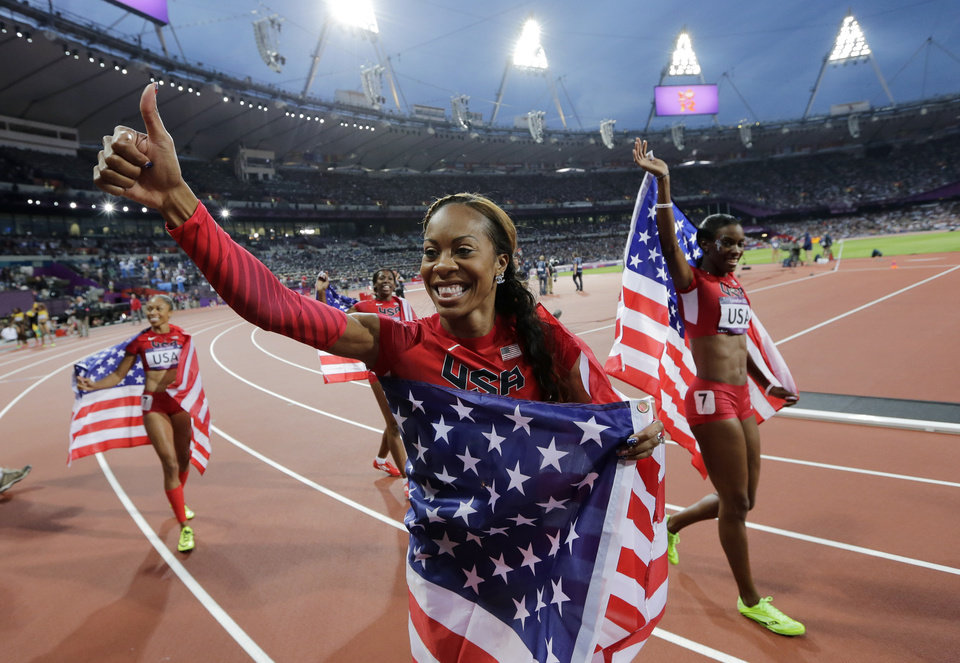 Photo -   United States' Deedee Trotter, right, United States' Sanya Richards-Ross, front center and United States' Allyson Felix, back left, celebrate winning gold in the women's 4x400-meter relay final during the athletics in the Olympic Stadium at the 2012 Summer Olympics, London, Saturday, Aug. 11, 2012. (AP Photo/David J. Phillip )