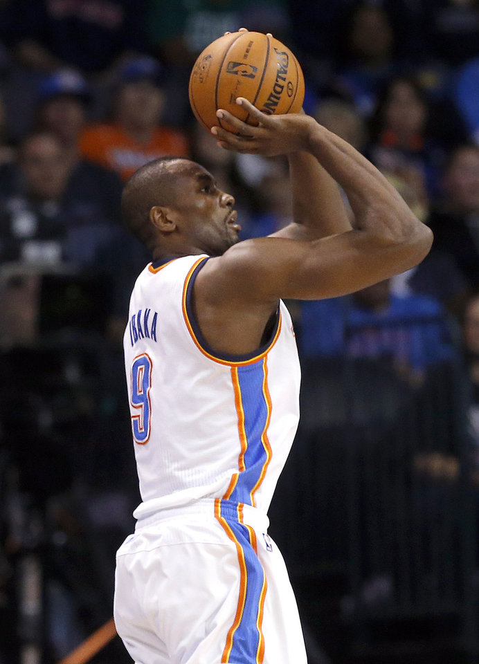 Oklahoma City\'s Serge Ibaka (9) shoots a three-pointer during the NBA game between the Oklahoma City Thunder and the Boston Celtics at the Chesapeake Energy Arena in Oklahoma City, Sunday, March 10, 2013. Photo by Sarah Phipps, The Oklahoman