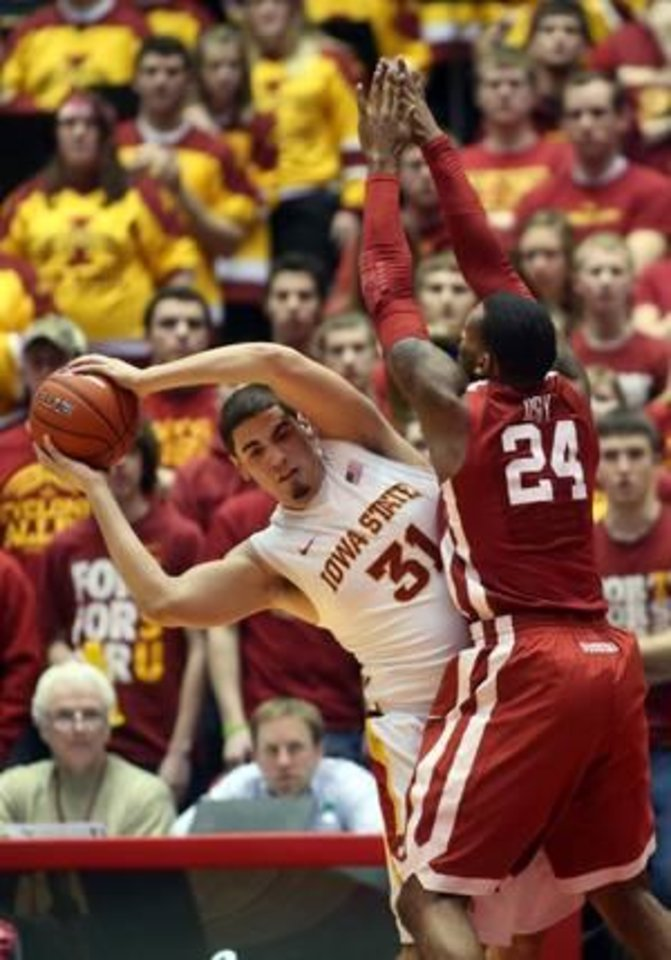 Iowa State forward Georges Niang (31) tries to work around Oklahoma forward Romero Osby (24) in the first half of an NCAA college basketball game Monday, Feb. 4, 2013, at Hilton Coliseum in Ames, Iowa. (AP Photo/Justin Hayworth
