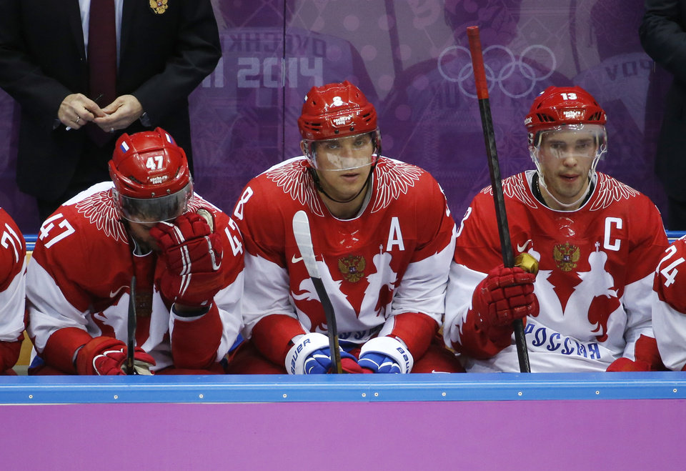Photo - Russia forwards Alexander Radulov, from left, Alexander Ovechkin and Pavel Datsyuk watch play against Finland late in the third period of a men's quarterfinal ice hockey game at the 2014 Winter Olympics, Wednesday, Feb. 19, 2014, in Sochi, Russia. (AP Photo/Mark Humphrey)
