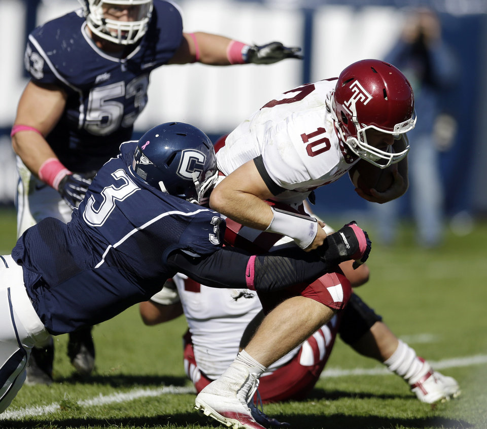 Connecticut linebacker Sio Moore (3) sacks Temple quarterback Chris Coyer (10) in the first quarter of an NCAA football game in East Hartford, Conn., Saturday, Oct. 13, 2012. (AP Photo/Michael Dwyer)