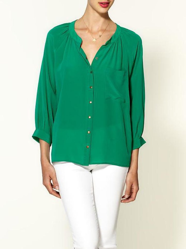 After color authority Pantone named emerald the official color of 2013, the green tone began popping up on runways and in stores everywhere. Here, Greylin silk button down blouse, $97, Piperlime.com. (Courtesy Piperlime.com via Los Angeles Times/MCT)