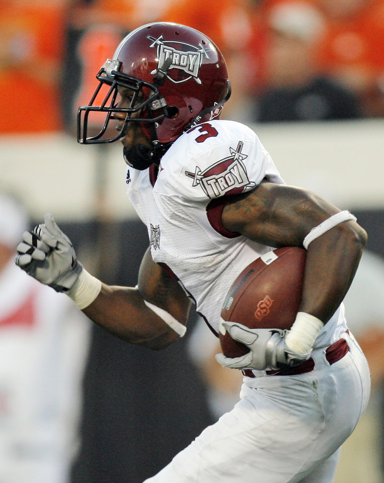 Photo - Troy's Jerrel Jernigan (3) returns a kickoff for a touchdown in the second quarter during the college football game between the Oklahoma State University Cowboys (OSU) and the Troy University Trojans at Boone Pickens Stadium in Stillwater, Okla., Saturday, Sept. 11, 2010. OSU won, 41-38. Photo by Nate Billings, The Oklahoman