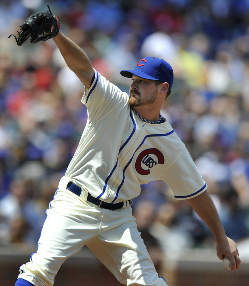 Photo - Chicago Cubs starter Travis Wood delivers a pitch during the first inning of a baseball game against the Milwaukee Brewers in Chicago, Sunday, May 18, 2014. (AP Photo/Paul Beaty)