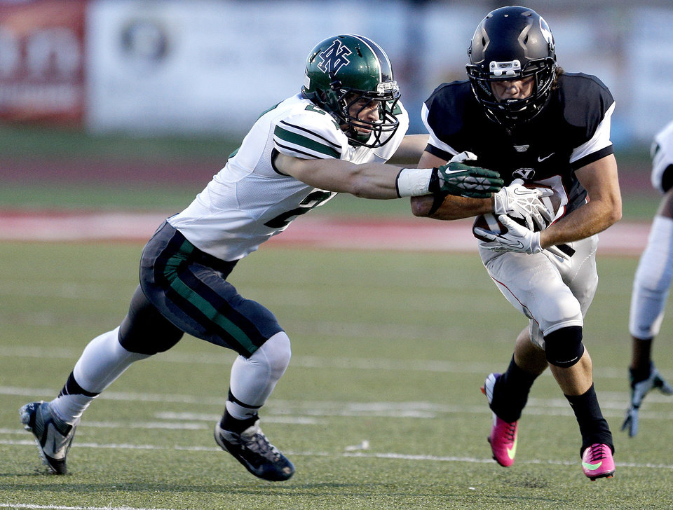 Norman North's Maguire Perrett tries to tackle Yukon's Parker Bohannan during a high school football game between Yukon and Norman North in Yukon, Okla.,   Friday, Oct. 4, 2013. Photo by Sarah Phipps, The Oklahoman